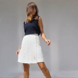 PLEATED WHITE WOLSEY SHORTS WITH SKIRT FRONT